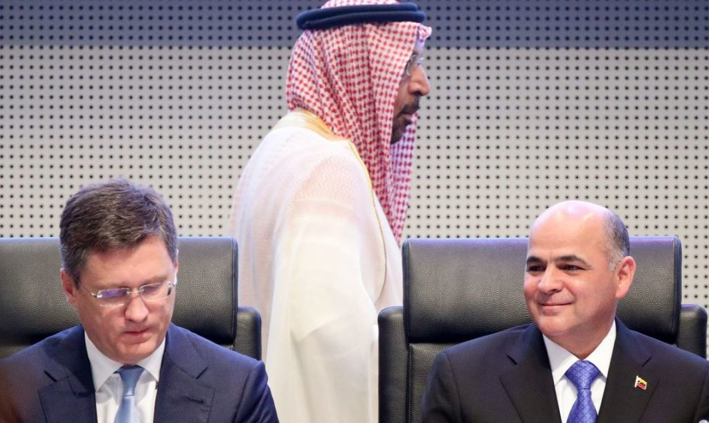 Russia's Energy Minister Alexander Novak, Venezuela's Oil Minister Manuel Quevedo and Saudi Arabia's Oil Minister Khalid Al-Falih are seen during the beginning of an OPEC and NON-OPEC meeting in Vienna, Austria, July 2, 2019. REUTERS/Lisi Niesner - RC1C3B0C35F0