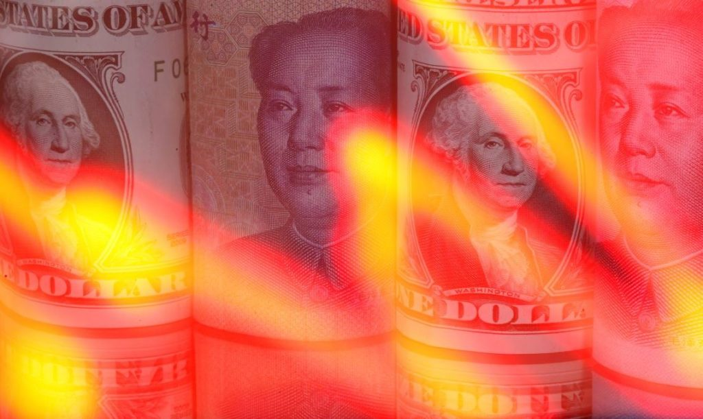 Chinese Yuan and U.S. dollar banknotes are seen behind illuminated stock graph in this illustration taken February 10, 2020. REUTERS/Dado Ruvic/Illustration - RC2KXE99X4B9