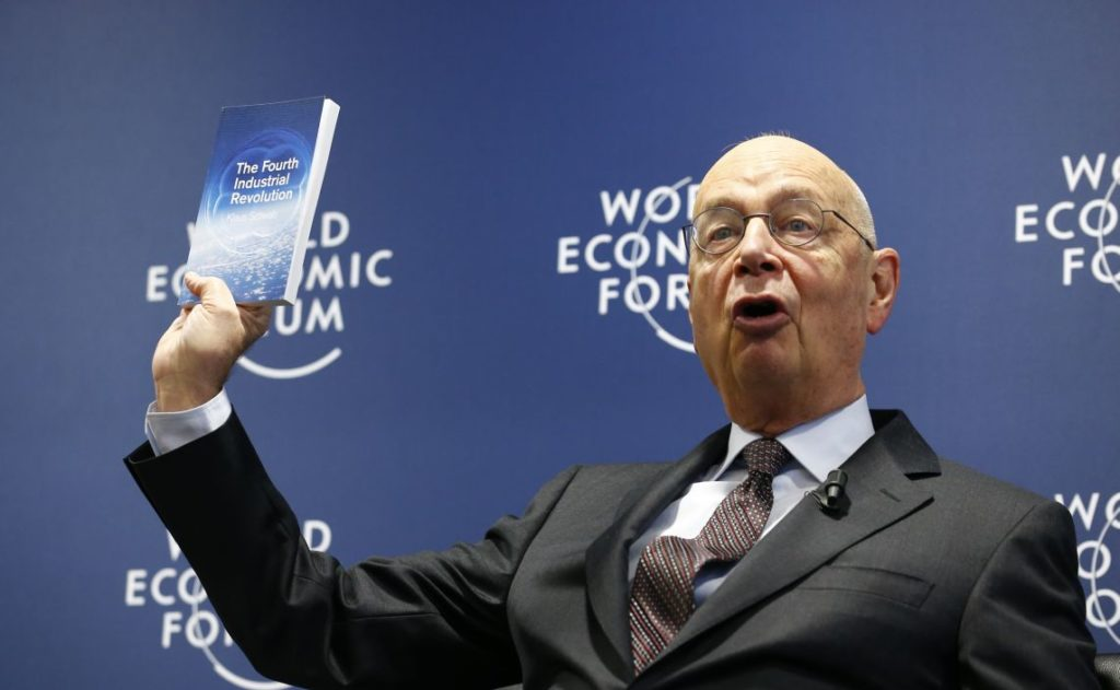 World Economic Forum (WEF) Executive Chairman and founder Klaus Schwab presents his book, 'The Fourth Industrial Revolution', during a news conference in Cologny, near Geneva, January 13, 2016. North Korea's foreign minister will attend the World Economic Forum meeting in Switzerland this month, organizers said, stepping on the international stage just weeks after Pyongyang's fourth nuclear test in defiance of a United Nations ban. REUTERS/Denis Balibouse  - LR2EC1D0TROM5