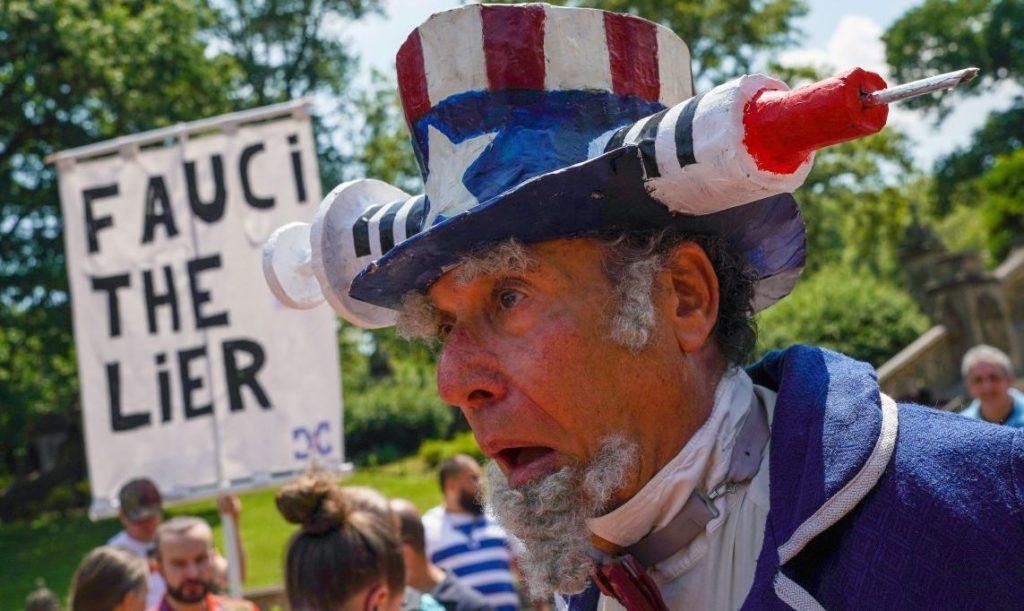 A man reacts during an anti-vaccine demonstration, amid the coronavirus disease (COVID-19) pandemic, in Central Park, New York City, U.S., July 24, 2021.  REUTERS/David 'Dee' Delgado - RC25RO99J8OS