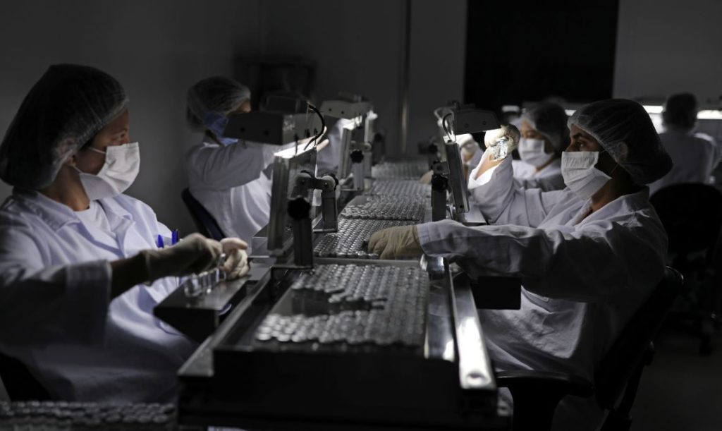 Women work at the inspection section where the Coronavac, SinoVac's vaccine against the coronavirus disease (COVID-19), will be produced, at Brazil's biomedical center Butantan Institute, in Sao Paulo, Brazil December 22, 2020. REUTERS/Amanda Perobelli - RC2LSK9HLKXW