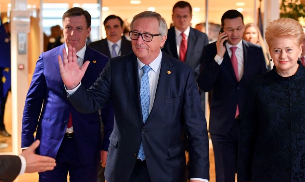European Commission President Jean-Claude Juncker, center, walks with from left, Latvian Prime Minister Maris Kucinskis, Polish Prime Minister Mateusz Morawiecki and Lithuanian President Dalia Grybauskaite prior to a meeting at EU headquarters in Brussels, Thursday, March 22, 2018. (AP Photo/Geert Vanden Wijngaert)