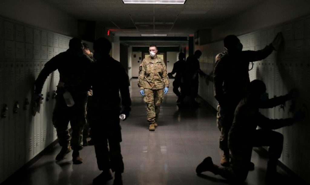 Members of Joint Task Force 2, composed of soldiers and airmen from the New York Army and Air National Guard, work to sanitize the New Rochelle High School during the coronavirus disease (COVID-19) outbreak in New Rochelle, New York, U.S., March 21, 2020. REUTERS/Andrew Kelly - RC2IOF9WWJFO