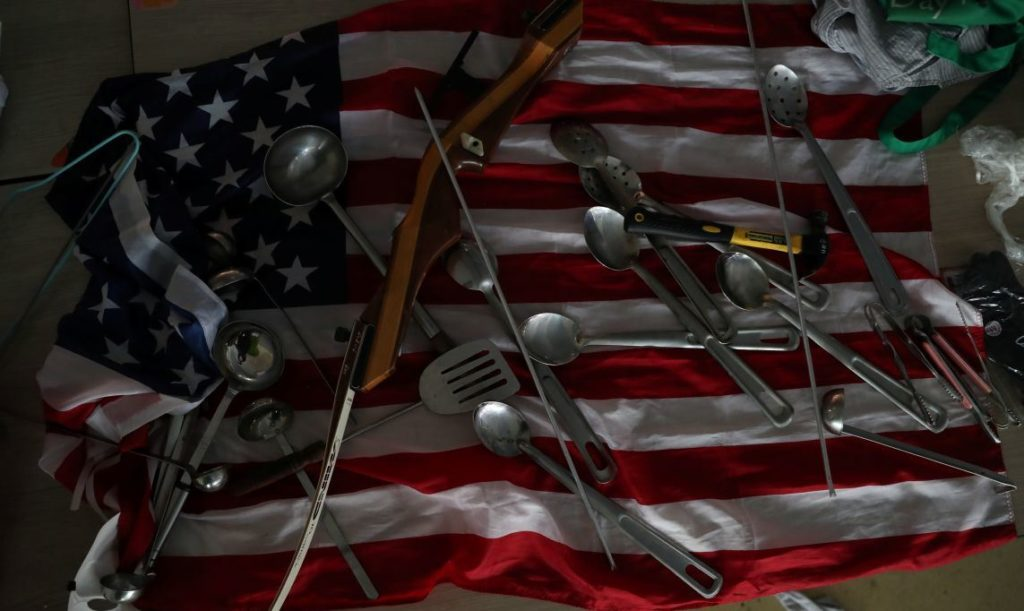 Utensils are laid out on a U.S. flag in a canteen in Hong Kong Polytechnic University (PolyU) in Hong Kong, China November 23, 2019. REUTERS/Leah Millis - RC2TGD9AZ6F6