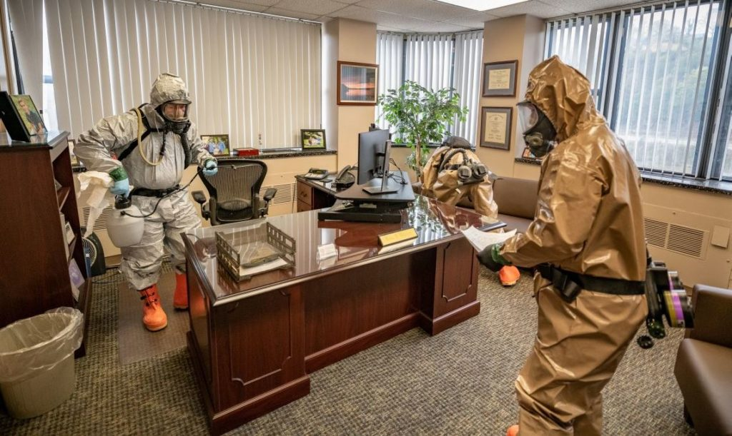 Members of the West Virginia National Guard's Task Force Chemical, Biological, Radiological and Nuclear (CBRN) Response Enterprise sanitize workspaces to help slow the spread of  coronavirus disease (COVID-19) for the West Virginia Higher Education Policy Commission in Charleston, West Virginia, April 11, 2020. Picture taken April 11, 2020. U.S. Army National Guard/Edwin L. Wriston/Handout via REUTERS.  THIS IMAGE HAS BEEN SUPPLIED BY A THIRD PARTY. - RC2Q3G9N52DD