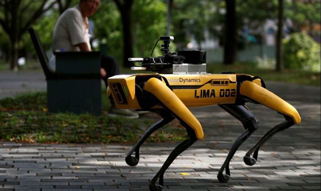 A four-legged robot dog called SPOT patrols a park as it undergoes testing to be deployed as a safe distancing ambassador, following the coronavirus disease (COVID-19) outbreak, in Singapore May 8, 2020. REUTERS/Edgar Su - RC29KG9PREZS