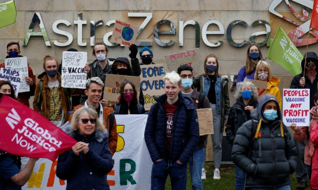 People hold signs during a demonstration outside Macclesfield AstraZeneca site, amid the coronavirus disease (COVID-19) pandemic, in Macclesfield, Britain, May 11, 2021. REUTERS/Phil Noble - RC2ODN97J9V7