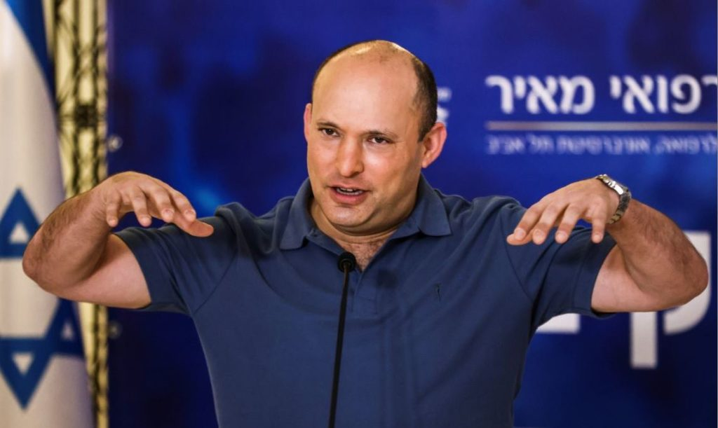 Israeli Prime Minister Naftali Bennett speaks to the media before receiving a third shot of the coronavirus disease (COVID-19) vaccine as Israel launches booster shots for over 40 year-olds in Kfar Saba, Israel August 20, 2021. REUTERS/Ronen Zvulun - RC2V8P9HA4LE